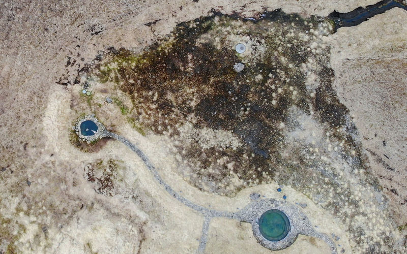 High angle view of wet sand