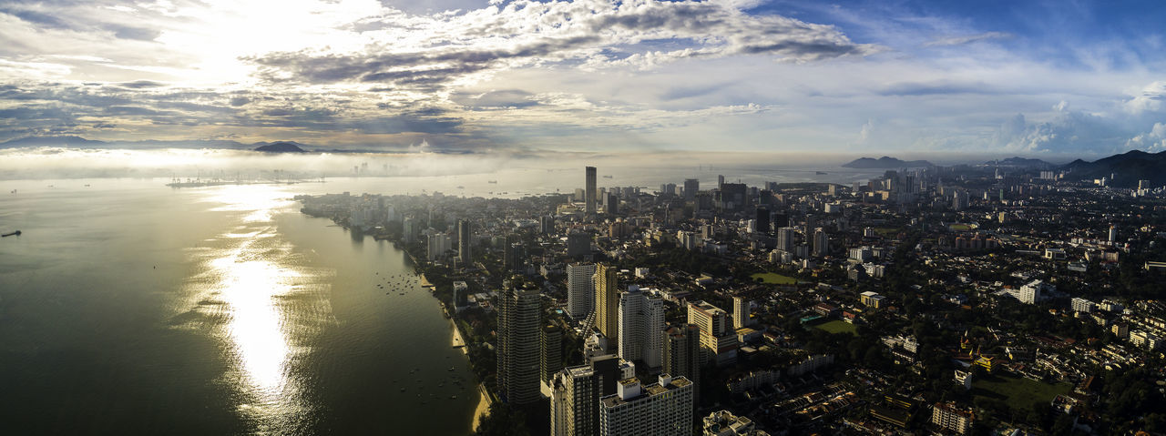 Aerial morning view Georgetown City, Penang, MALAYSIA. Building Exterior Cloud - Sky City Sky Architecture Cityscape Built Structure Water Building Nature Reflection Skyscraper Office Building Exterior High Angle View No People Landscape Aerial View Urban Skyline Outdoors Bay Penang Drone  Komtar Bridge Heritage