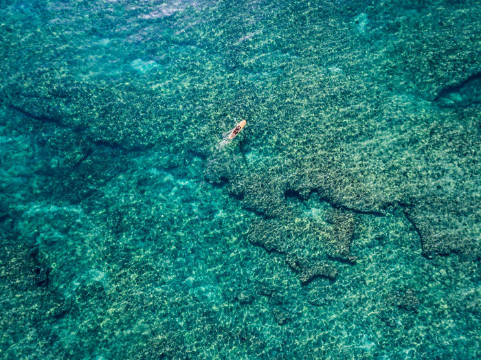 Aerial view of paddleboard on turquoise sea