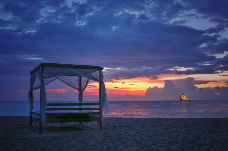 sunrise in bali, indonesia Bali Beach Bed Canopy Canopy Bed Day Bed Horizon Over Water Relax Sea Sunrise Tranquil Scene Tranquility Travel Vacation My Favorite Place