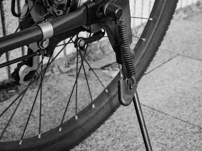 Low section of bicycle on footpath in city