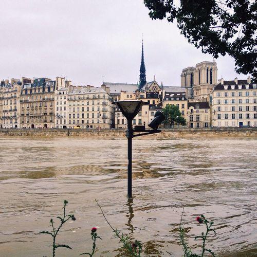 Seine River By Notre Dame De Paris Against Sky