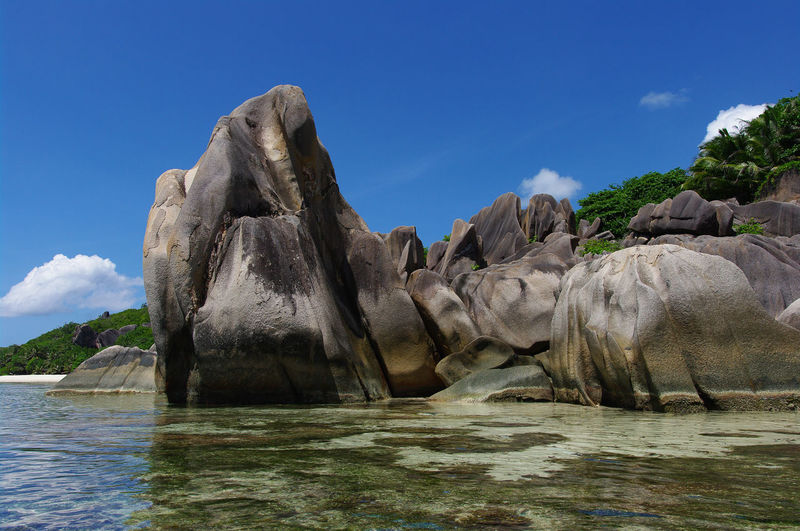 Seychelles Anse Source D'argent Nature Beauty In Nature Scenics - Nature No People Seychelles Beach Sand White Sand Palm Tree Travel Destinations Paradise Paradise Beach Ocean Natuer_collection Nature Colorful Sky Stone Rocks Rock - Object Green Color Beauty In Nature Africa Cloud - Sky