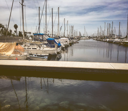 Marina Boats California Cloud - Sky Clouds Day Docks Harbor Marina No People Outdoors Palm Trees Reflection Sailboat Scenics Sky Southern California Southern California Coast Tranquility Transportation Vintage Vintage Looks Water Waterfront Yacht