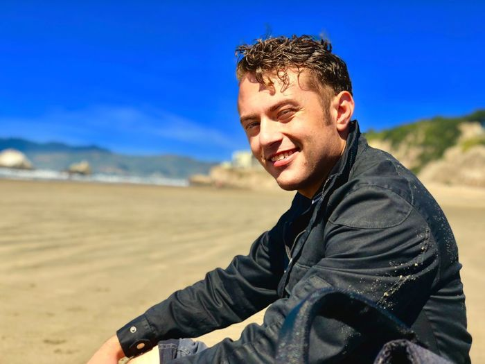 Portrait of smiling young man at beach
