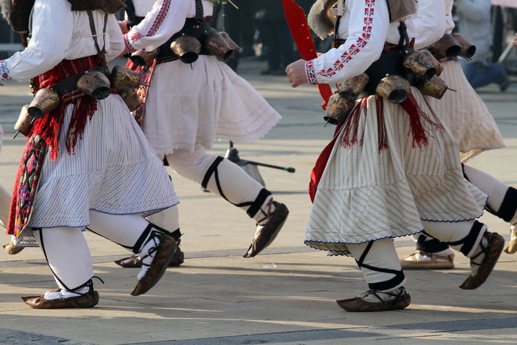 Low Section Of Men In Traditional Clothing Dancing On Road