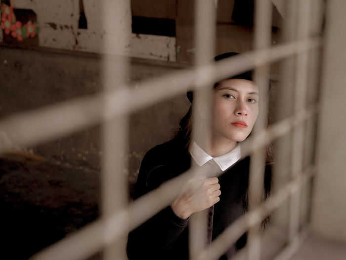 Detain Detention Beautiful Woman Classroom Classroom Moments Contemplation Looking One Person Portrait Railing Real People Selective Focus Window Young Adult Young Women