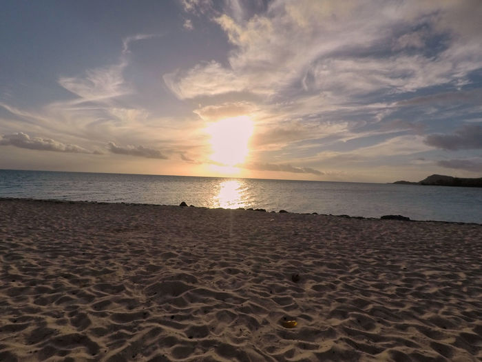Sky Cloud - Sky Land Sea Scenics - Nature Beauty In Nature Beach Water Horizon Over Water Sand Horizon Tranquility Tranquil Scene Sunset Non-urban Scene Idyllic Nature Sun No People Outdoors Moorea French Polynesia