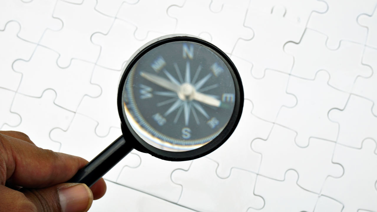 magnifying glass, scrutiny, map, human hand, puzzle, close-up, discovery, human body part, indoors, one person, day, people