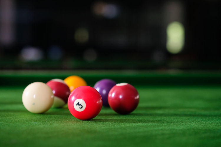 Close-up of multi colored balls on pool table