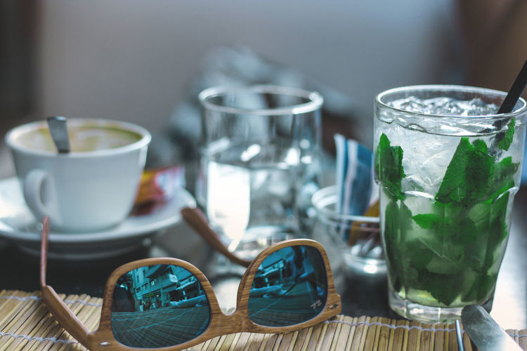 Close-Up Of Drink And Sunglasses On Table