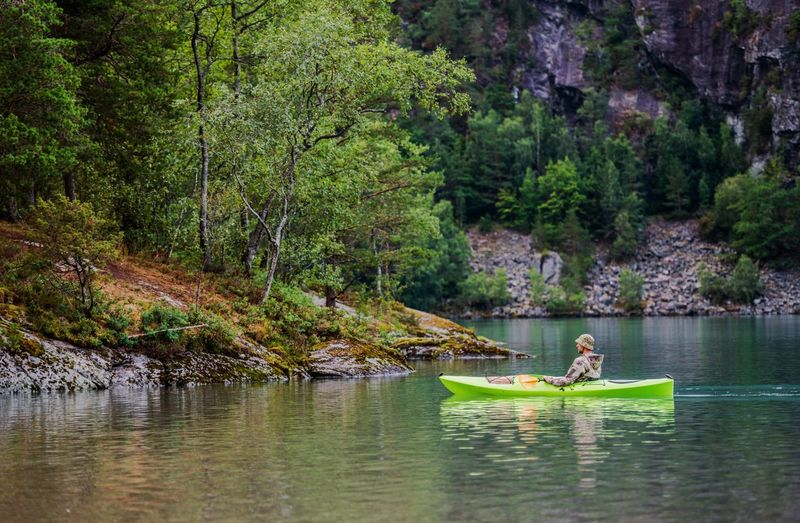 Relaxing Kayak Tour. Caucasian Men on the Scenic Lake. Kayak Kayaking Activity Sport Norway Glacial Lake Landscape Scenery Scenics Caucasian Water Nautical Vessel Tree Plant Transportation Nature Forest Lake Beauty In Nature Day Mode Of Transportation Men Leisure Activity Two People Waterfront People Tranquility Travel Outdoors Rowboat Inflatable
