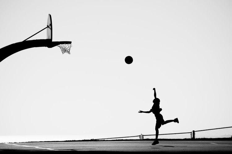 The next Air Jordan Balance Basketball Basketball Game Basketball Practice Clear Sky Day Energy Enjoyment Exercising Freedom Full Length Fun Jumping Leisure Activity Lifestyles Mid-air Motion Outdoors Play Playing Silhouette Silhouette Of People Skill  Sky Sport