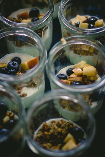 Close-up of food in glass jars on table