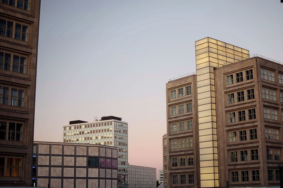 Pastel city. Berlin Pastel Sunset Built Structure Architecture Building Exterior Sky Building City Window No People Clear Sky Residential District Outdoors Office Building Exterior Travel Destinations Travel The Architect - 2018 EyeEm Awards
