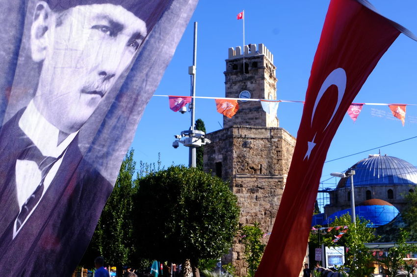 The old clock tower and its surrounding in the center of Antalya Turkey Türkei Antalya Clock Tower Uhrturm Kaleiçi Flag Atatürk Mosque