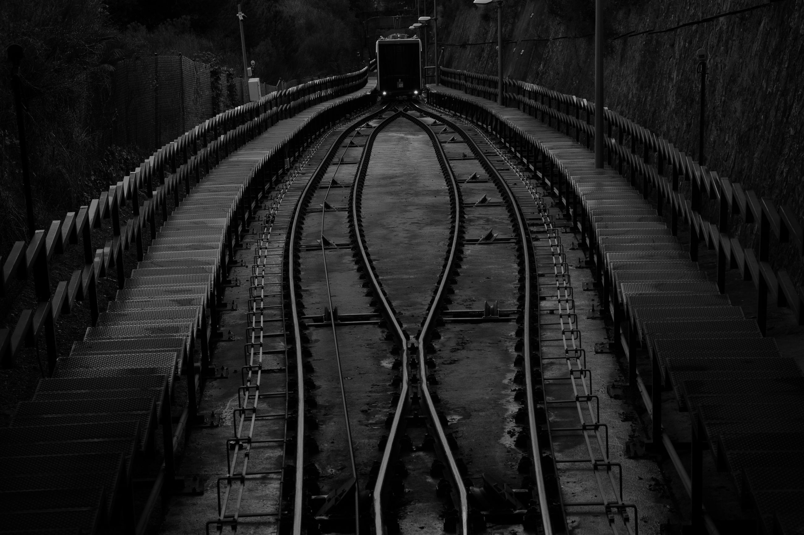 rail transportation, track, railroad track, transportation, the way forward, direction, no people, public transportation, mode of transportation, architecture, high angle view, travel, diminishing perspective, built structure, metal, connection, in a row, outdoors, curve, tree, shunting yard, long