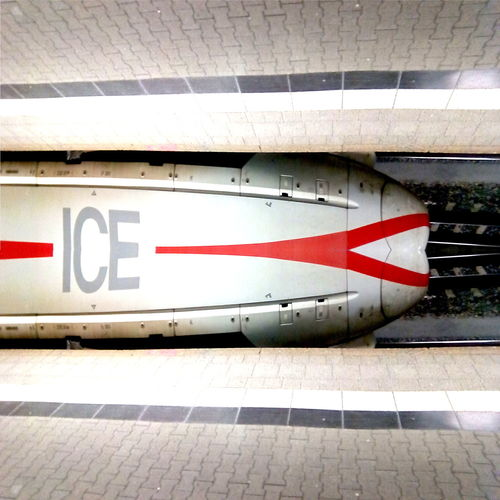 waiting for the express Bosch Built Structure City Deutsche Bahn Futuristicdesign GIMP Photo Editor Greyscale Horizontal Mirrored Ice Intercity Express  Logo Look Twice New Pattern Part Of Railroad Station Platform Railway Red Reflection Symetricphoto Tecnology Tiled Floor Train Transportation Transpotation UbuntuPhone Cut And Paste