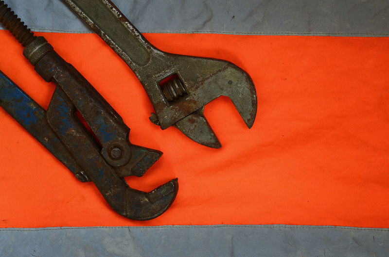 Close-up of work tools on reflective clothes