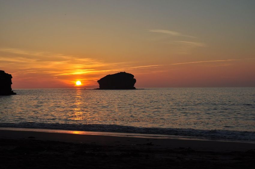 Sunset, Gull Rock, Portreath, Cornwall, UK Sunset Water Sky Beauty In Nature Beach Sea Nature Tranquility Horizon Over Water Scenics Tranquil Scene Idyllic No People Silhouette Outdoors
