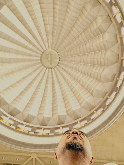 Low angle view of man against ceiling