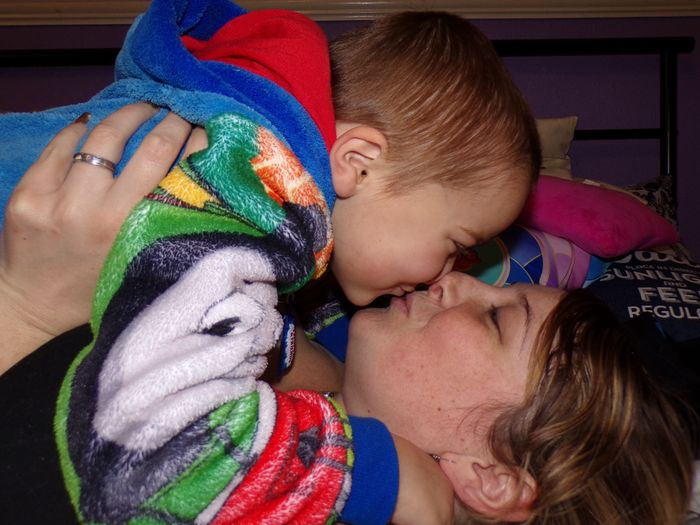 Close-Up Of Mother Kissing Boy