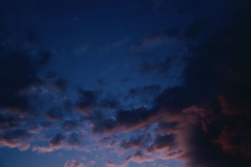 Low angle view of dramatic sky at night