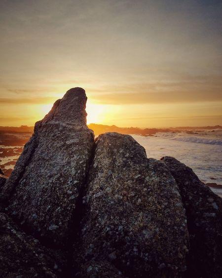the ocean sunset Sea Sunset Beach Rock Formation Nature Horizon Over Water Scenics Landscape Sky Tranquil Scene