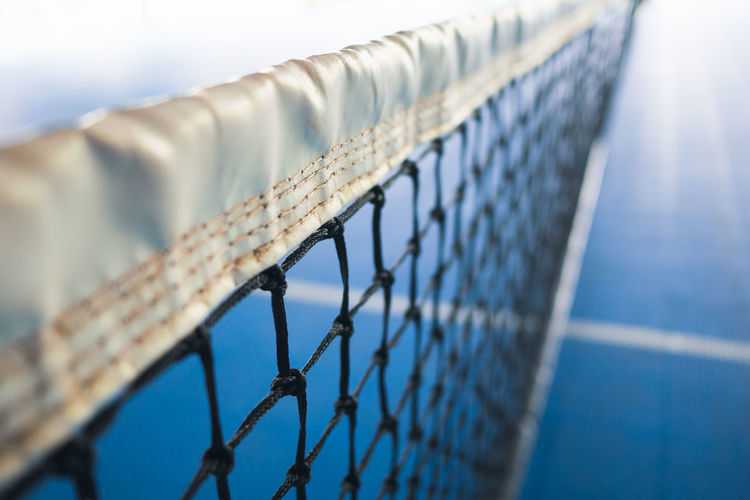 Close-up of tennis net on court