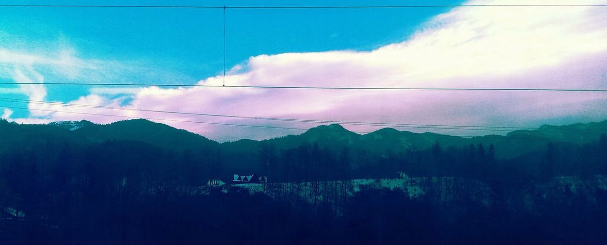 Mountain Cable Sky Beauty In Nature Nature Power Line  Scenics Perspectives On Nature Tranquil Scene Tranquility Cloud - Sky Outdoors Tree No People Blue Electricity Pylon Landscape Electricity  Day