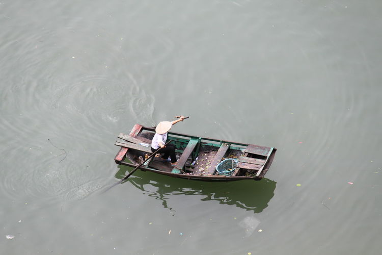 High Angle View Of Person Rowing Boat In River