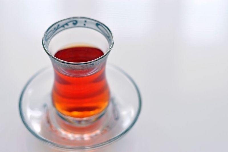 High angle view of black tea in glass on table