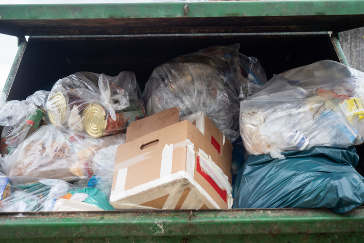 A dumpster full of mixed garbage Bin Brown City Clean Dirty Dumpster Environment Garbage Garbage Container Mixed Garbage Old Plastic Recycle Recycling Refuse Rubbish Trash Urban Used Waste Wet