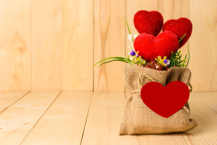 Close-up of red heart shaped flowers on table