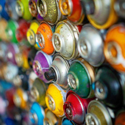 Full frame shot of multi colored spray bottle