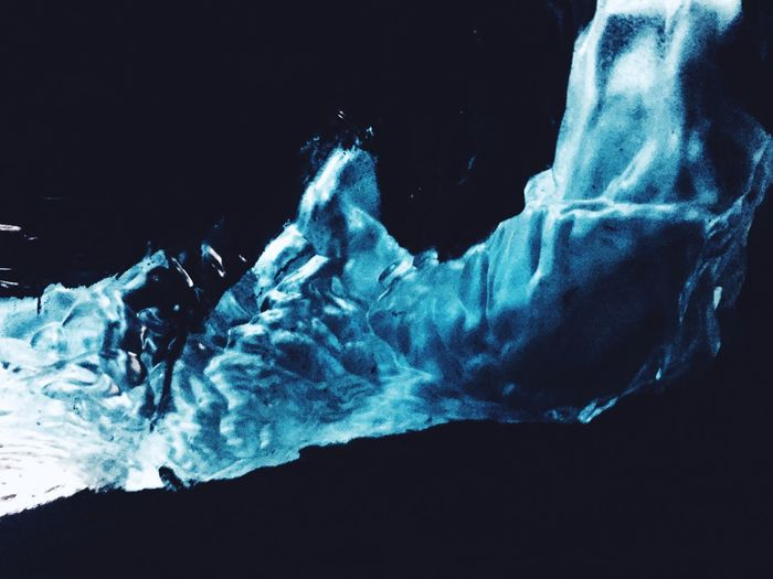 Close-up of ice against black background