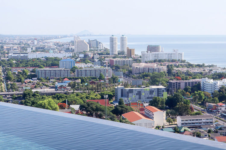 Hua Hin , Thailand  Thailand Aerial View Architecture Building Building Exterior Built Structure City Cityscape Day High Angle View Horizon Horizon Over Water Nature No People Office Building Exterior Outdoors Plant Residential District Sea Sky Skyscraper Tree Water