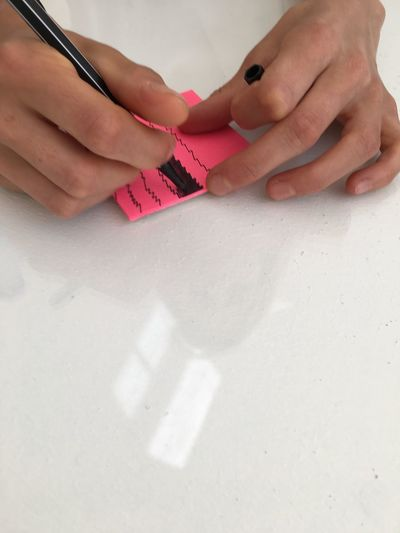Cropped Hands Of Woman Scribbling On Sticky Note
