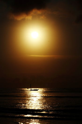sunset viewed from Pananjung Pangandaran Beauty In Nature Day Horizon Over Water Idyllic Nature No People Orange Color Outdoors Reflection Scenics Sea Silhouette Sky Sun Sunlight Sunset Tranquil Scene Tranquility Water Waterfront