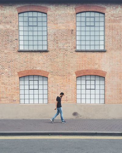 Adult Adults Only Architecture Architecture Building Exterior Built Structure City Day Full Length Leisure Activity Lifestyles London Minimal Minimalism Minimalist One Person Outdoors Pedestrian People Real People Strideby Symmetry The Street Photographer - 2017 EyeEm Awards Window Young Adult