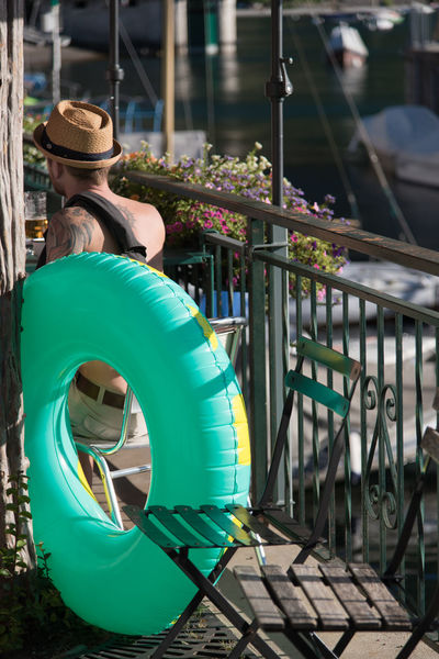 Outdoors Green Color Day Real People Man One Man Only Hat Buoy Life Vest Summer Vacations Leisure Activity Drinking Resting Lying Down Bar