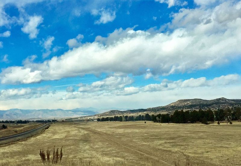 Clouds drifting over prairie landscape before approaching storm over Colorado's Front Range Rural Countryside Colorado View Prairie Landscape Cloud - Sky Sky Scenics Beauty In Nature Tranquil Scene Nature Mountain Outdoors Field Mountain Range No People