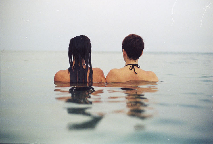 Rear view of women swimming in pool