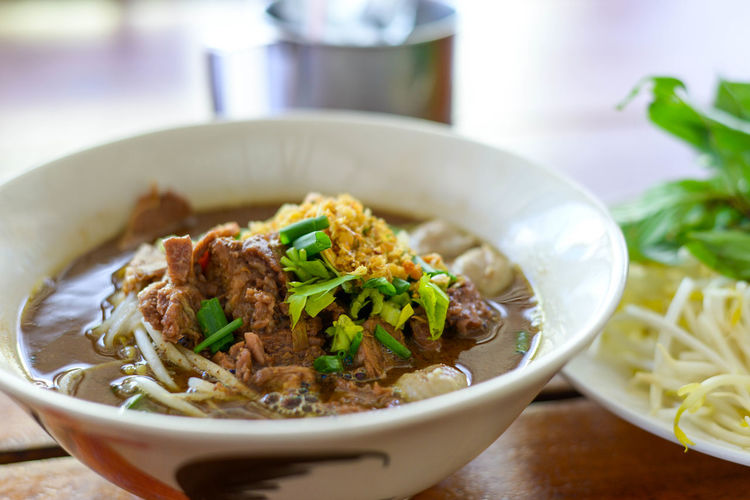 Close-up of noodle soup in bowl on table