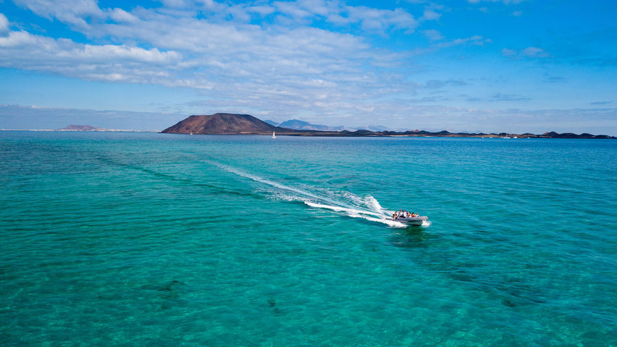 Sea Water Nautical Vessel Sky Transportation Beauty In Nature Scenics - Nature Cloud - Sky Travel Mode Of Transportation Day Nature Motion Wake - Water Blue Waterfront Speed Outdoors No People Turquoise Colored