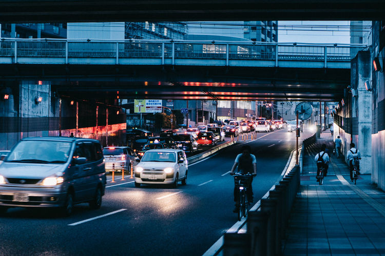 Architecture Bridge Bridge - Man Made Structure Building Exterior Built Structure Car City City Life City Street Group Of People Illuminated Incidental People Land Vehicle Mode Of Transportation Motion Motor Vehicle Outdoors Road Street Traffic Transportation Travel EyeEmNewHere