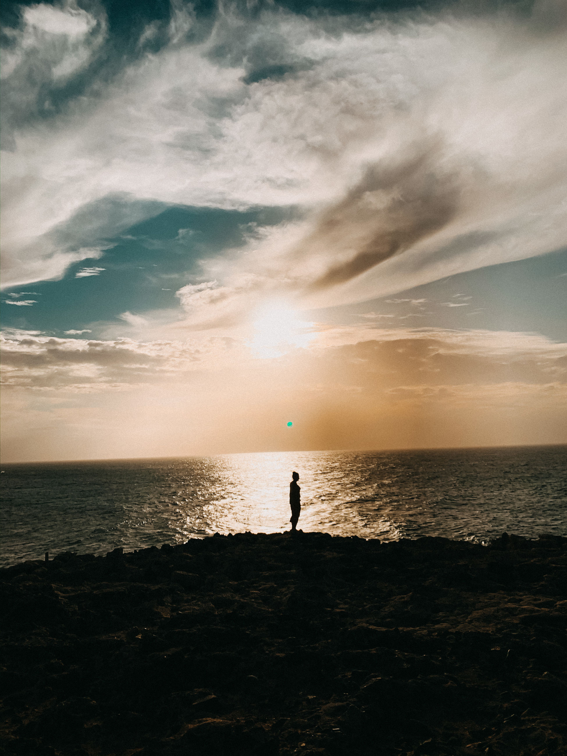 sea, sky, water, horizon over water, horizon, beauty in nature, cloud - sky, scenics - nature, land, standing, beach, sunset, silhouette, nature, real people, tranquility, tranquil scene, lifestyles, rock, outdoors