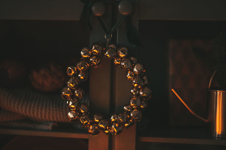Close-up of lighting equipment hanging at home