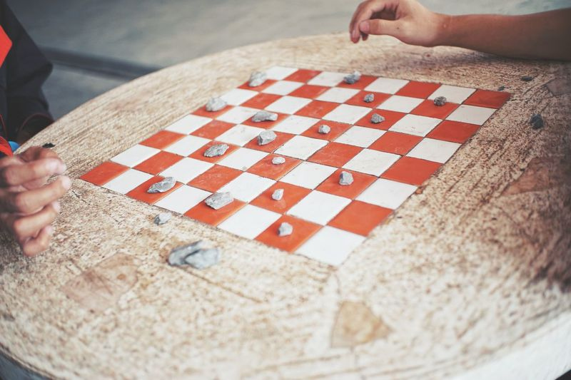 Checkers. Human Hand Indoors  Men People Gambling Chip Chess Board Checkers Duel Stone Game Close-up Day