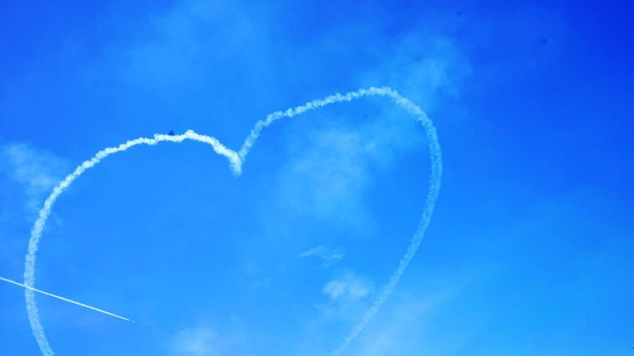 Pierced heard in air Sky Heart Shape Heart Pierced Heart UAE Abu Dhabi Cloud - Sky Blue Vapor Trail Sky Airplane Air Vehicle Flying Airshow Low Angle View on the move Transportation No People Day Speed